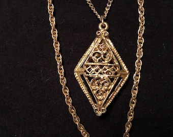 Gold-tone chain necklace with charms (est. 1970s)