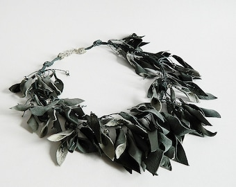 Gray colored leaves leather necklace with glass beads. Statement necklace.