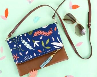Vegan Tassel Clutch - Navy Floral Crossbody Handbag - Gold zipper, Blue tassel, and tan faux leather