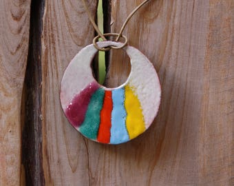 Multicolored pendant, torch fired enamel on copper