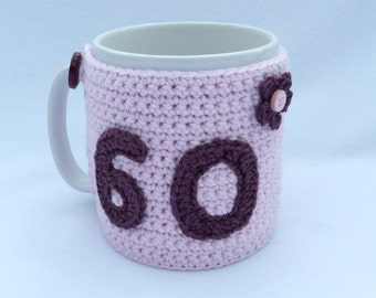 60th Birthday pink crochet mug cozy. Homewares, birthday gift, accessories, 60th birthday gift