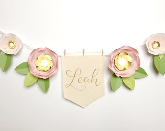 paper flower garland blush pink and gold with personalized hand lettered flag banner