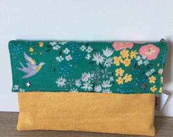 Clutch in green and yellow bi-material
