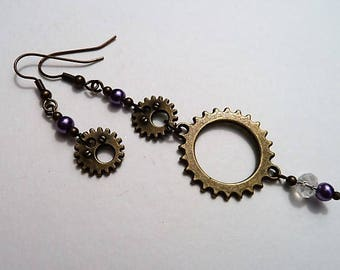 Asymmetric steampunk cog earrings with purple pearls and a sparkling crystal