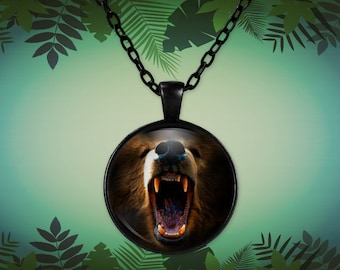 Angry bear, beautiful up close photo showing his sharp teeth on a round pendant necklace in black or silver