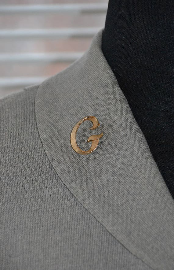 vintage-trifari-brooch---lady-g---monogram-initial-lapel-pin---retro-60s by etsy