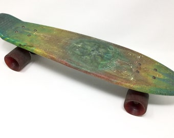 Vintage 70s Lotus plastic skateboard Studtruck multi color