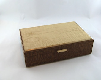Tea box in lacewood on the side 12 X 7 3/4 x 3 3/8.Top is made from Figured maple . Item 185