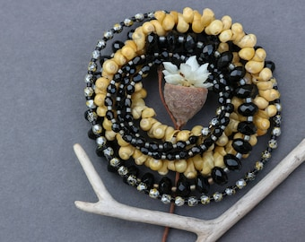 long beaded necklace with small yellow sea shells and black glass beads - ethnic boho jewelry - thin layering necklace
