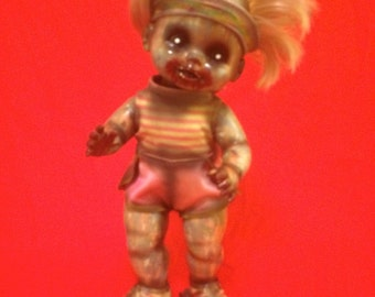 Smashly Judd is a OOAK zombie baby art doll