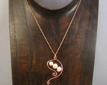 Pink pearl necklace with copper swirls