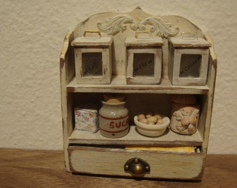 miniature dollhouse, shelf with drawer and the three wooden jars