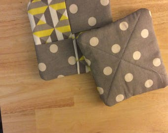 Geometric and dots in yellow, grey and white