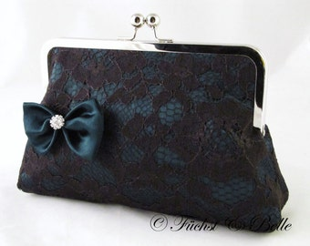 Lace clutch purse with satin bow in dark teal and black lace