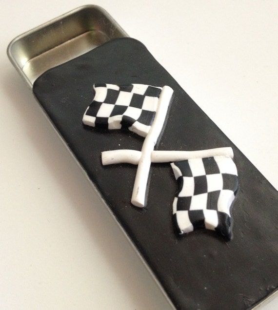Your off to the races with this Pill Box, choose one of my many designs. Lid is made of polymer clay and super durable.