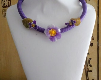 Purple tubular choker with three real dried and laminated flowers