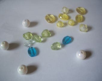 Assortment of beads, white, green, blue