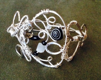 Black and White Swirling Whirls Wire Bracelet
