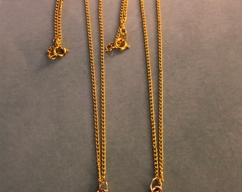 Two Gold plated shell necklaces