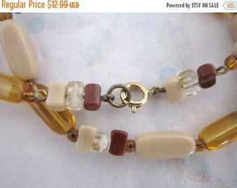 ON SALE vintage glass bead necklace in beige topaz and browns - j3585
