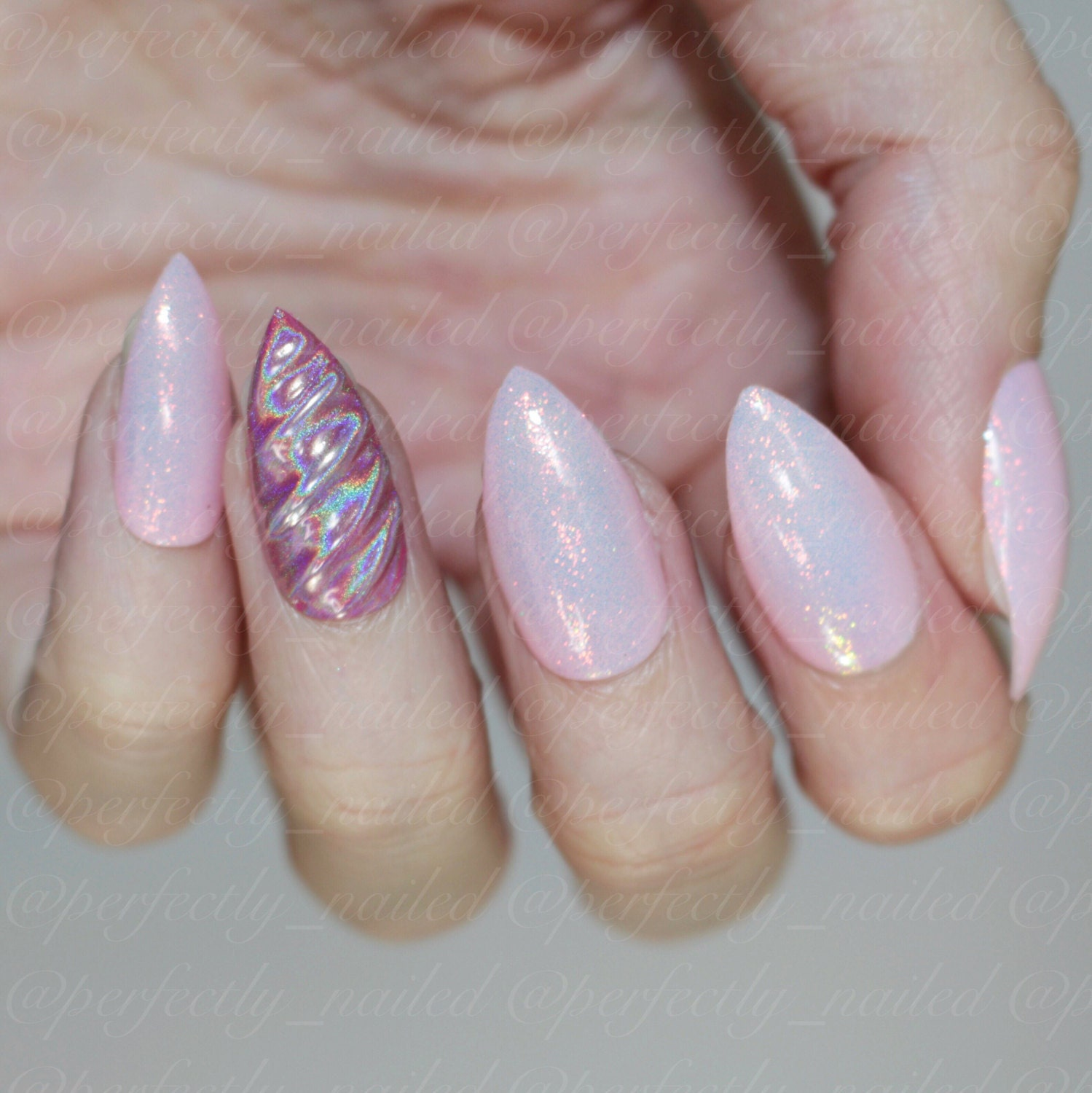 Unicorn gel nails with mermaid and holographic powder