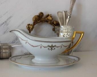 Old porcelain sauceboat,porcelain sauce server