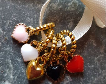 5 small  knitting stitch markers. Golden Hearts