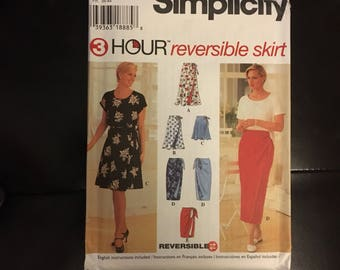 Womens reversable wrap skirt sewing pattern short, knee and midi length from the 1990's  Simplicity 7118 sizes extra small, small and medium