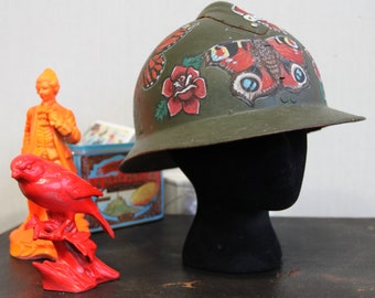 Army World War II helmet with tattoo style artwork