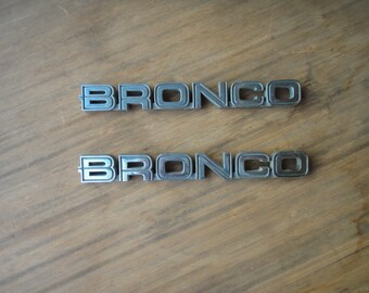 Vtg Bronco Emblem pair guessing from 80's