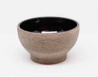 Handmade ceramic bowl with rough texture