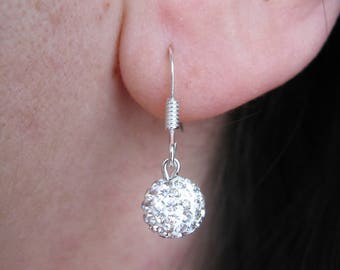 925 sterling silver adorned with a SWAROVSKI ball earrings
