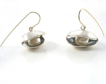 Sterling silver original clam earrings with fresh water pearl, your choice black or white pearl on solid gold wires. Unique design for shell