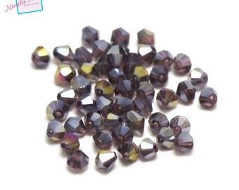 "90/30 Crystal beads ""spinning"" 4 x 4 mm purple iridescent"