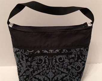 "LIP2- Lunch Bag: ""Black Is The New Black"" washable insulated lunch bag with zippered front pocket and zippered top closure."