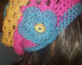 Granny stitch slouchy hat with flower and button accent