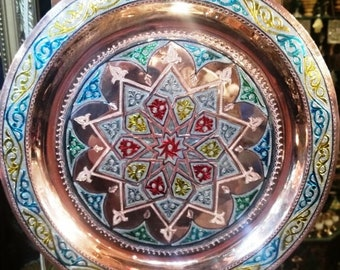 "Built copper decorations reflect the art of Moroccan craftsmanship, round tops ""Soigni"""