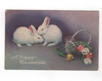 A Happy Eastertide. Antique postcard with bunnies, basket, tulips. Collectible ephemera card embellishment scrapbook collage.