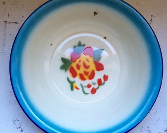 Large enamel bowl with flower decoration