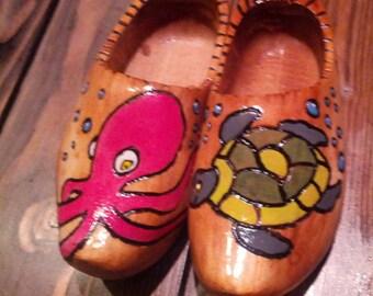 Handmade decorative wooden clogs.