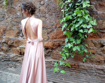 Elegant long dress face powder color satin fabric, with cross neckline in front and bow back.