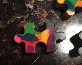 Multicolored puzzle piece crayons