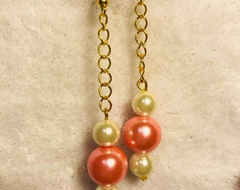 Long pearls pink and white on gold chain