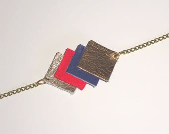 brass and bright red, dark blue leather bracelet, gold and bronze
