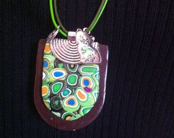 Green tones mosaic pendant on Brown background