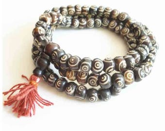 Whole necklace of 108 beads in 8 yak bone hand carved mala 9 mm