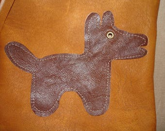 Flat clutch in Tan Leather and his dog
