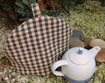 A soft wool tea cosy, size large.  To fit a 4 - 5 cup teapot.  Large cosy.