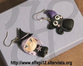 Halloween witch earrings and black kitten
