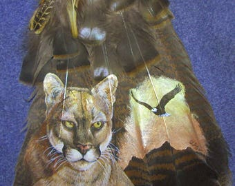 Panther and eagle on turkey feathers